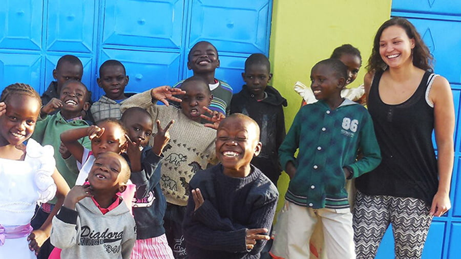 Jaimini Organization with group of African kids